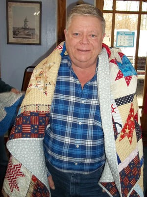 Thomas Nelsen, of Flippin, was recently awarded a Quilt of Valor by the Mountain Home Quilts of Valor. Nelsen served in the US Marine Corps in Vietnam. He received the quilt at a ceremony held at Beacon Point Restaurant in Lakeview, attended by family and friends.