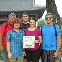 Several members of the Callies family from Brandon traveled to South Korea for two weeks this summer to visit, Sarah Callie, who is deployed to South Korea with the SD Air National Guard. The Callies brought a bit of home along with them, the Brandon Valley Challenger. Pictured are, from left, Kevin K. Callies, Brian Callies, Kevin R. Callies, Sarah Callies and Casey Callies. They are pictured in front of one of the palaces that the group toured in Seoul Korea. If you're venturing out - whether near or far - remember to pack your hometown newspaper, the Brandon Valley Challenger, so we can let our readers know where you - and the Challenger - have been!