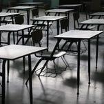 This Detroit Free Press file photo shows empty school desks.