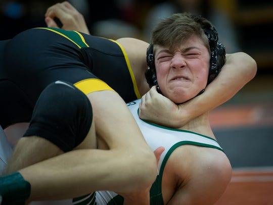 Trinity's Austin Hedges wrestles with St Xavier's Nathan