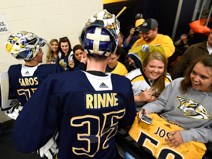 Predators goalie Pekka Rinne interacts with fans after