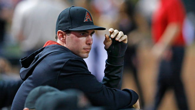 Arizona Diamondbacks first baseman Paul Goldschmidt (44) watches the action with a cast on his had from the dugout during the 2nd inning of their MLB game against the Pittsburgh Pirates  Saturday, Aug. 2, 2014 in Phoenix, Ariz.