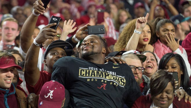 Alabama linebacker Reggie Ragland (19) poses with fans following the College Football Playoff Championship Game on Monday January 11, 2016 at University of Phoenix Stadium in Glendale, Ariz.