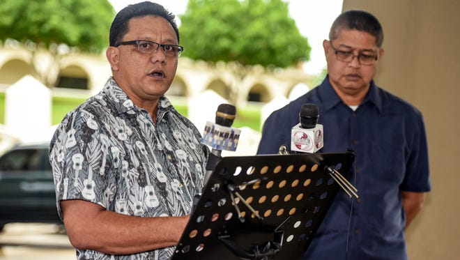 Roland Sondia, left, of Agat, Guam, responds to a question during a press conference Sept. 22, 2016. Sondia made a public appeal to Gov. Eddie Calvo to pass Bill 326 that would remove the statute of limitations on civil suits regarding sexual abuse of children.