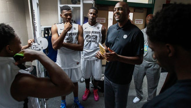 July 17, 2014 - Team Penny head coach Penny Hardaway ( right) jokes with his players after defeating the NY Lightning 86-70 in their game of the EYBL finals at the Peach Jam in North Augusta, S.C.   (Mark Weber/The Commercial Appeal)