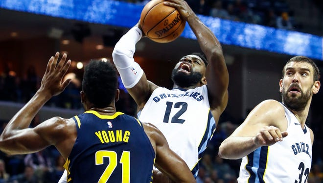 Memphis Grizzlies guard Tyreke Evans (middle) puts up a shot over Indiana Pacers forward Thaddeus Young (left) during second quarter action at the FedExForum in Memphis, Tenn., Wednesday, November 15, 2017.