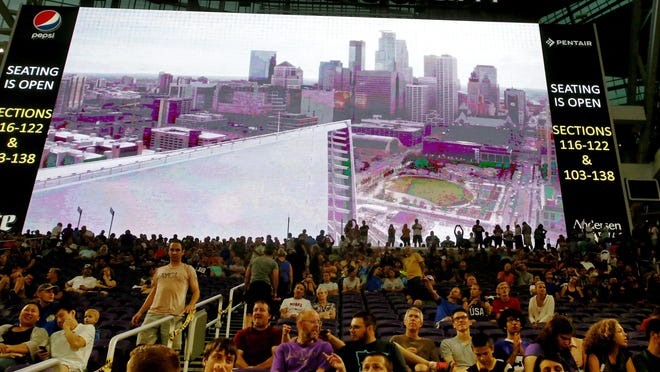 A large video display backs Minnesota Vikings fans on Saturday at the public opening at U.S. Bank Stadium in Minneapolis.