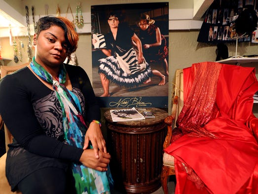 Local fashion designer Nikki Blaine will be showing an all-red collection at 26th annual Meet the Artists exhibit and gala reception on Feb. 8 at the Central Library, 40 E. St. Clair St. She was photographed in her studio at116 N. Main St.,  Zionsville.