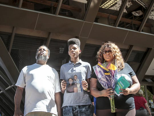 Sarah Coleman, the mother of Dalvin Hollins, who was killed by police, stands with her husband, Frederick Franklin, and son Devin Franklin, 15, at a press conference outside Tempe City Hall on July 29, 2016.