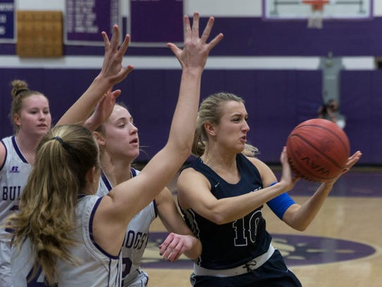 Manasquan's Dara Mabrey passes out to an open player