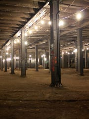 This Aug. 15, 2012, photo provided The Lowline shows the abandoned trolley terminal deep underground in New York's Lower East Side, which may one day house a park.