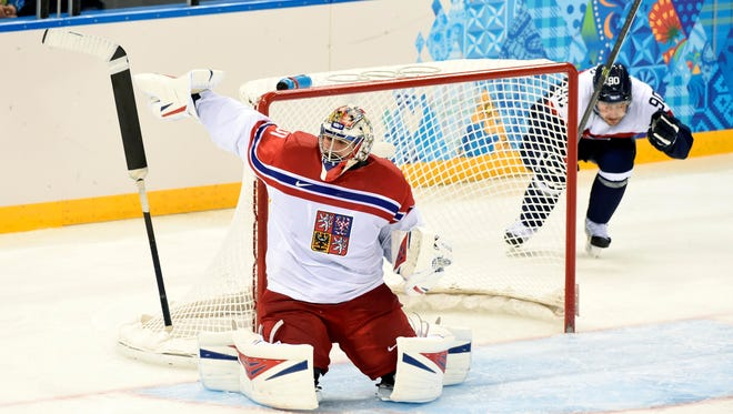 Czech Republic goalie Ondrej Pavelec (31) loses his stick as he makes a save against Slovakia on Tuesday.