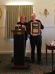 Debbie Blake presents a thank-you gift to Jay Bratten