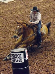 Amanda Hewitt competes in barrel racing at the Rapides