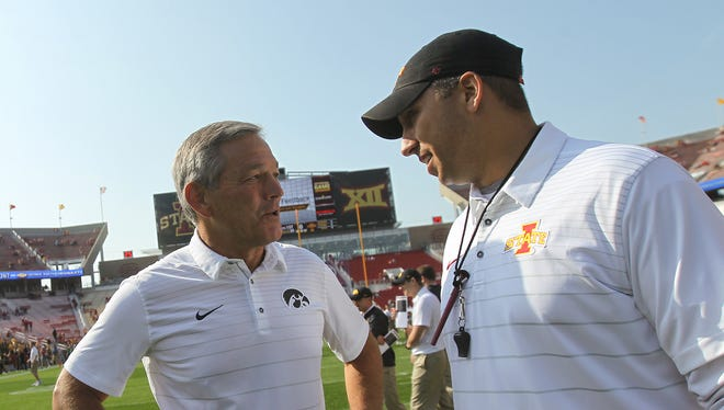 Iowa head coach Kirk Ferentz and Iowa State head coach Matt Campbell chat before their game at Jack Trice Stadium in Ames on Saturday, Sept. 9, 2017.