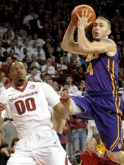 LSU guard Keith Hornsby (4) looks for a shot past Arkansas