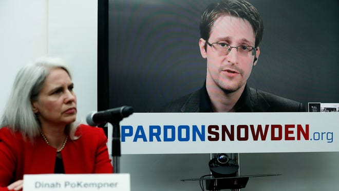 Dinah PoKempner, left, general council for Human Rights Watch, listens in New York as Edward Snowden speaks from Moscow on Sept. 14, 2016.