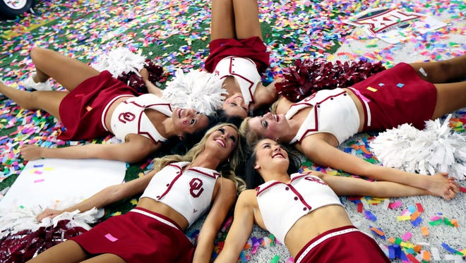 Oklahoma Sooners cheerleader celebrate after the game against the TCU Horned Frogs in the Big 12 Championship game at AT&T Stadium.