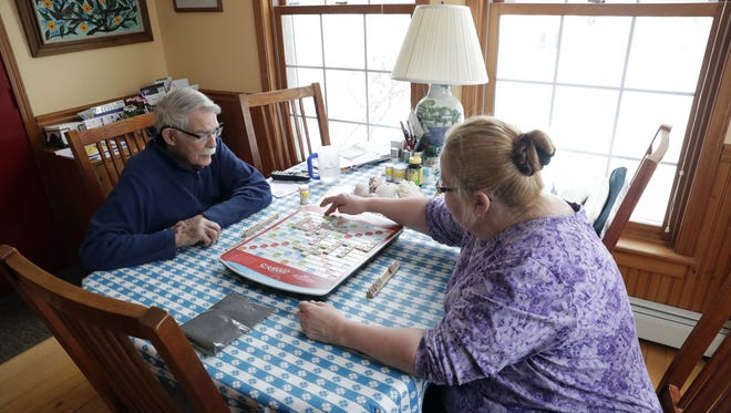 Jack Zito, 96, and Lisa Jeansonne, an end-of-life doula and caregiver, play Scrabble at Zito's kitchen table on Jan. 24, 2018 in Sister Bay, Wis. Sarah Kloepping/USA TODAY NETWORK-Wisconsin