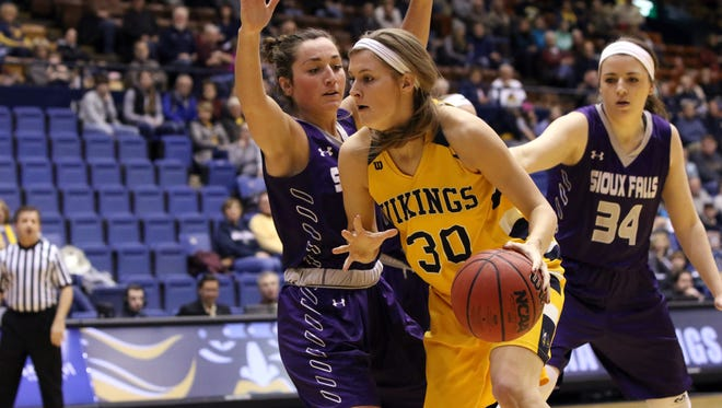 Logan O'Farrell of Augustana dribbles past the defense of Augusta Thramer of USF during Friday night's game at the Arena.