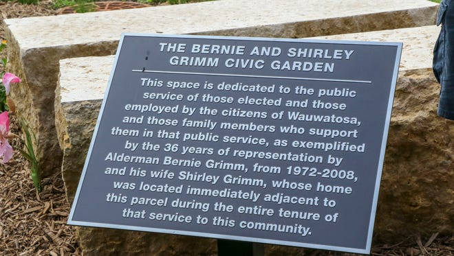 A plague honoring former alderman Bernie Grimm and his wife Shirley Grimm is dedicated on July 23 during a ceremony.