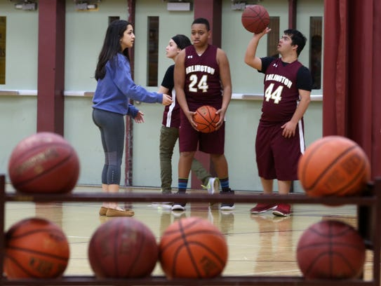 From left, Arlington junior Camille Loussedes works