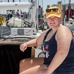 Crew member Olivia Knupp, 16, of Port Huron sits in her favorite spot on the Passinthru Monday, July 18, 2016 at Mackinac Island after the Port Huron-to-Mackinac Island Sailboat Race.
