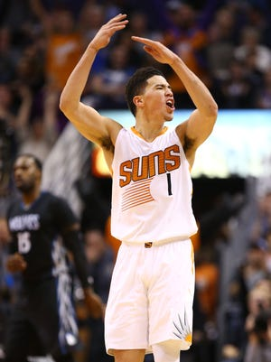 Phoenix Suns Devin Booker (1) reacts after making a 3-pointer against Minnesota Timberwolves in the 4th quarter on Jan. 24, 2017 in Phoenix, Ariz.