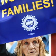 A strike on Saturday, Sept. 13, 2014, has shut down the Lear plant in Hammond, Ind., according to a statement from the United Auto Workers. The plant makes seats for a nearby Ford assembly plant in Chicago. In this photo, retired UAW worker Wilma Amster of Louisville, Ky., is shown holding a sign during an AFL-CIO rally supporting collective bargaining that was held at the Indiana Statehouse in March 2011.