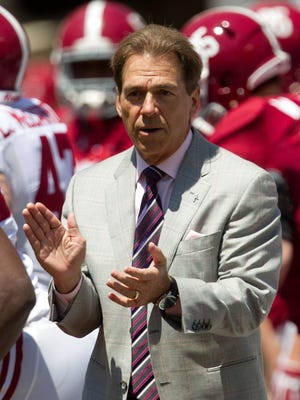 Alabama Crimson Tide head coach Nick Saban brings the team on to the field prior to the A-Day game at Bryant-Denny Stadium.