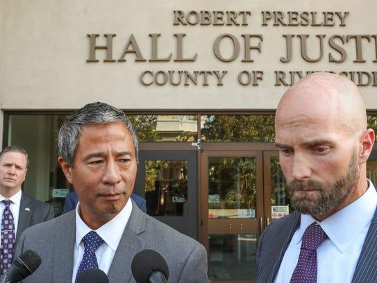 Riverside County prosecutors John Aki, center, and