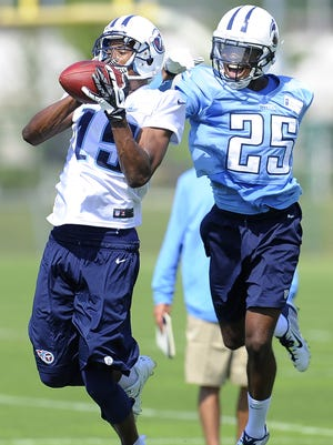 Titans wide receiver Justin Hunter makes a catch against cornerback Blidi Wreh-Wilson during practice at Saint Thomas Sports Park on Saturday.