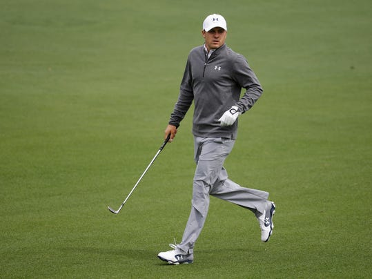 Jordan Spieth runs down the second fairway during a practice round for the Masters golf tournament Tuesday, April 8, 2014, in Augusta, Ga. (AP Photo/Darron Cummings)