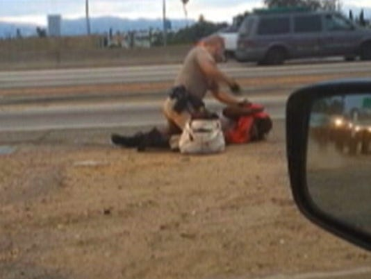 AP Highway Patrol Woman Punched