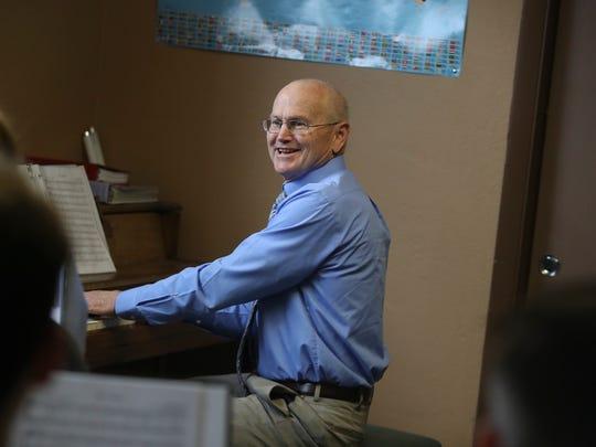 Liberty Christian Administrator Tom Adams leads the