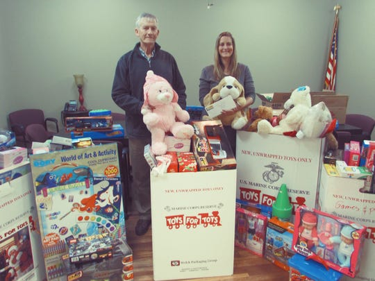 Volunteers Mike Kidd and Angela Kidd, both Realtors with Keller Williams Realty in Murfreesboro, picked up this year's Middle Tennessee Association of Realtors donations to Toys for Tots.