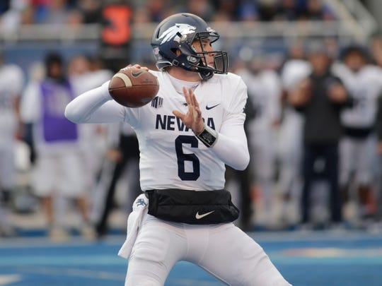 Nevada quarterback Ty Gangi (6) passes during the first half of an NCAA college football game against Boise State in Boise, Idaho, Saturday, Nov. 4, 2017. (AP Photo/Otto Kitsinger)