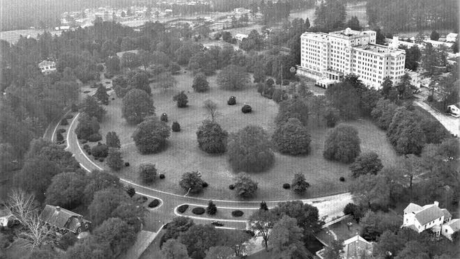 The former Forrest Ricker Hotel, shown here shortly before its demolition, became a military hospital in the 1940s.