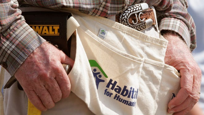 Former President Jimmy Carter has his hammer ready as he pauses while building a Habitat for Humanity house in Violet, La., Monday, May 21, 2007. Carter was working on the 1000th Habitat for Humanity house in the Gulf Coast region since hurricane Katrina and Rita.
