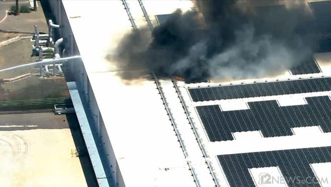 A helicopter captured a fire at a southeast Valley warehouse on May 26,  2015.