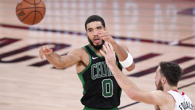 The Celtics' Jayson Tatum makes a pass during Friday's Eastern Conference finals game against the Heat. Going into Sunday night's game, Tatum was averaging 25.8 points, 10.2 rebounds and 4.6 assists while playing 40.4 minutes per game.