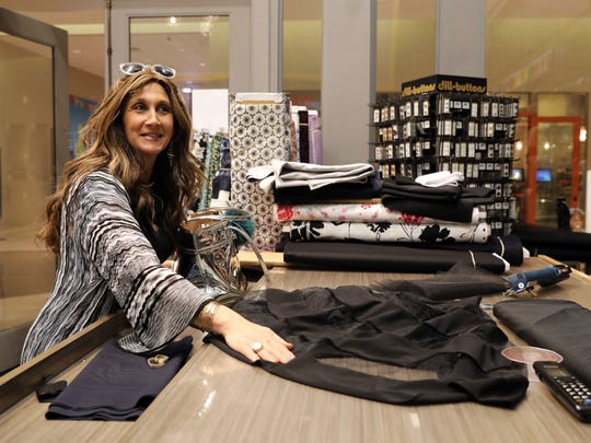Bassie Friedman of Pomona buys fabric for a dress she needs lengthened for an awards dinner April 30, 2018 in Monsey.