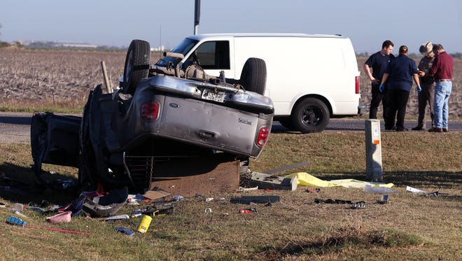 Texas Department of Public Safety Officers work the scene where a man was killed in a crash on County Road 69 near Robstown Tuesday, November 287, 2017.  A gray F-150 pickup was traveling east on Farm-to-Market Road 2826 about 7 a.m. The pickup stopped at a stop sign, but failed to yield the right-of-way and entered County Road 69, Public Information Officer Nathan Brandley said.