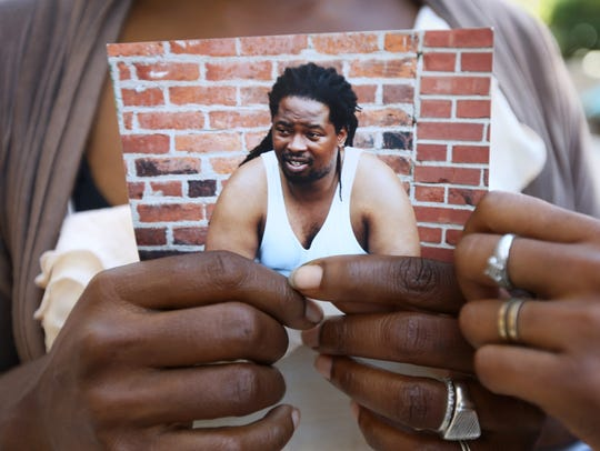 Kimberly Thomas of Clifton holds a photo of Samuel
