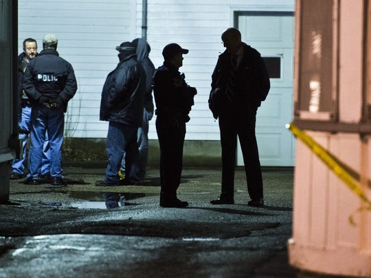 Multiple police and DEA resources stand by at a home off Elmwood Avenue in Burlington night following an officer-involved shooting Dec. 22.