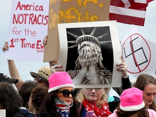 636520668750105907-Women-s-March-Florida.jpg