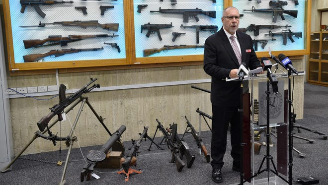 Detective Chief Inspector Wayne Hoffman of the New South Wales Police speaks to the media at a press conference at their headquarters in Sydney on on Aug. 8, 2017, as guns previously seized from criminals are seen behind him.  More than 6,000 guns were surrendered in Australia's most populous state in just one month, police said.