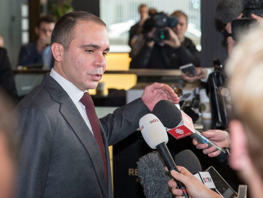 FIFA presidential candidate,  Prince Ali Al Hussein of Jordan,  answers  questions as he arrives at  the CONCACAF Extraordinary Congress held at the Renaissance hotel in Zurich, Switzerland, Thursday, Feb.  25, 2016. Candidates are making their final pitches to secure votes for Friday's election to succeed Sepp Blatter as FIFA president.   (Patrick B. Kraemer/Keystone via AP)