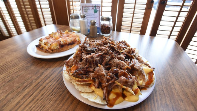 The pulled pork nachos at Deano's Pizza and Big Zeke's BBQ in McConnelsville are made with pulled pork made in the restaurant's own smoker. Also pictured is a personal sized bacon double cheesburger pan pizza.