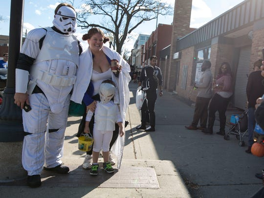Robert Beckman from Warren, left, dressed as a Storm Trooper, Laura Laise, dressed as Princess Leia, top right, from Southfield and her son Joseph Beckett, bottom right, 3, dressed as a Storm Trooper have their photo taken during the Royal Oak Spooktacular on Sunday, Oct. 25, 2015 in downtown Royal Oak. Tim Galloway/Special for DFP